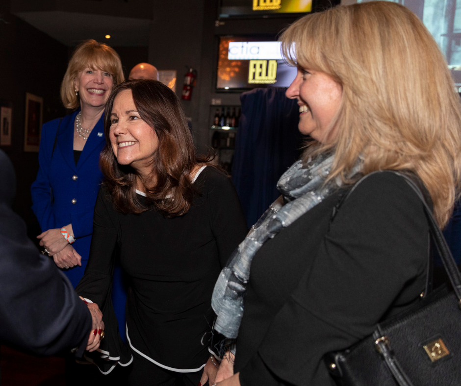 Mrs. Pence with two HJF teammates at a reception in March 2019.