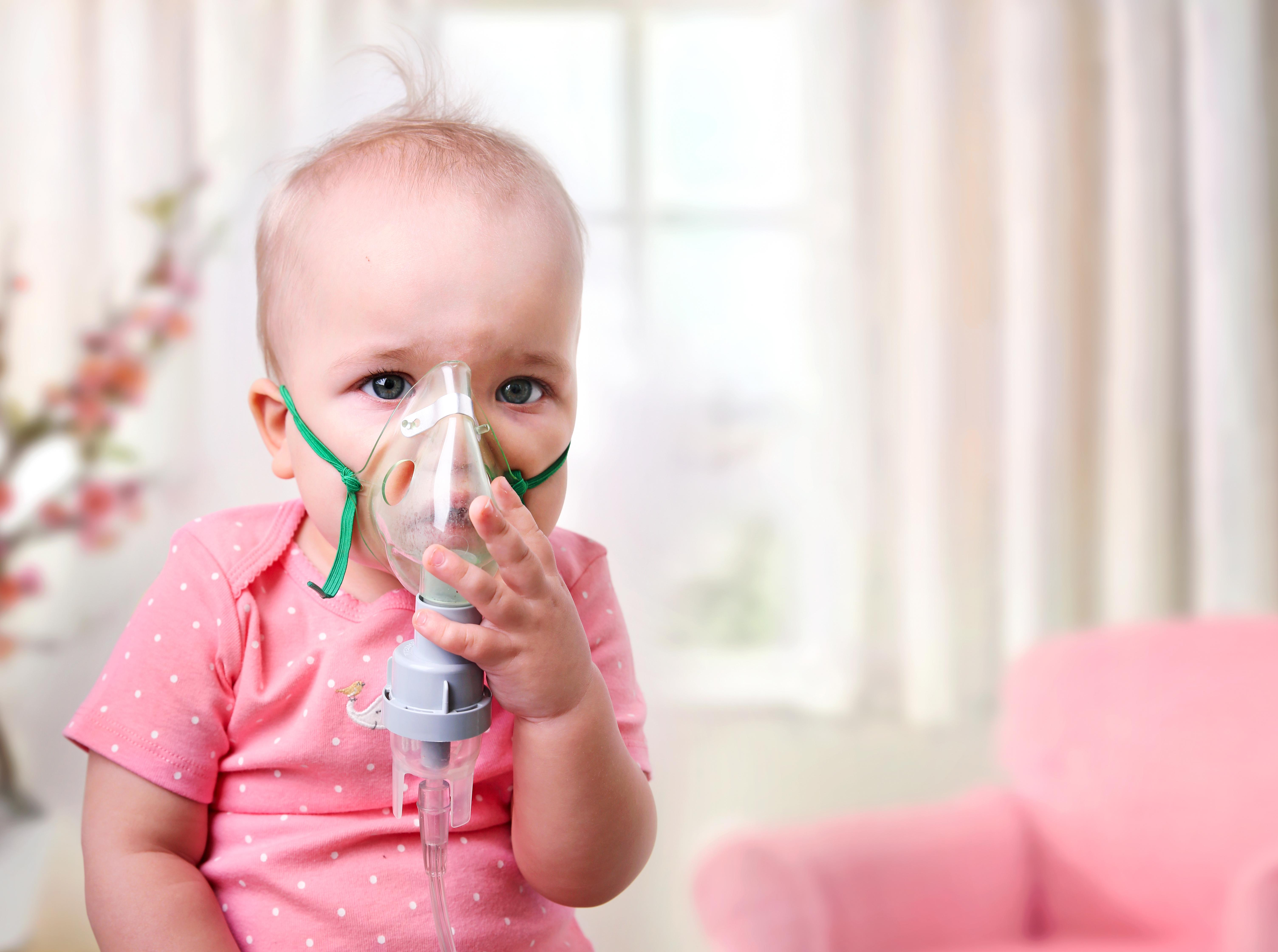 Baby with oxygen mask