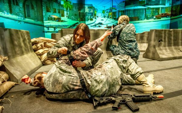 Troops practice a simulation of wounded and medic.